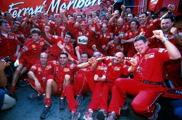 Race winner Michael Schumacher (GER) celebrates victory with the Ferrari team. San Marino Grand Prix, Imola, Italy, 2 May 1999.