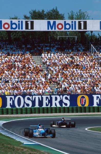 Johnny Herbert (GBR) Benetton B195 leads local hero Heinz-Harald Frentzen. German GP, Hockenheim, 30 July 1995