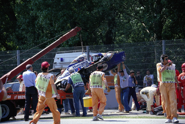 Ayrton Senna's Williams FW16 Renault is removed after his fatal accident.