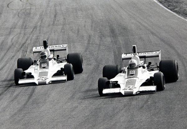 1975 Dutch Grand Prix.Zandvoort, Holland.20-22 June 1975.Tony Brise (Hill GH1-Cosworth) 7th position and Alan Jones (Hill GH1-Cosworth) 13th position, action.World Copyright - LAT Photographic