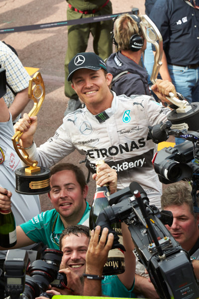 Monte Carlo, Monaco. Sunday 25 May 2014. Nico Rosberg, Mercedes AMG, 1st Position, celebrates with the winning drivers and constructors trophies in hand. World Copyright: Steve Etherington/LAT Photographic. ref: Digital Image SNE12347 copy