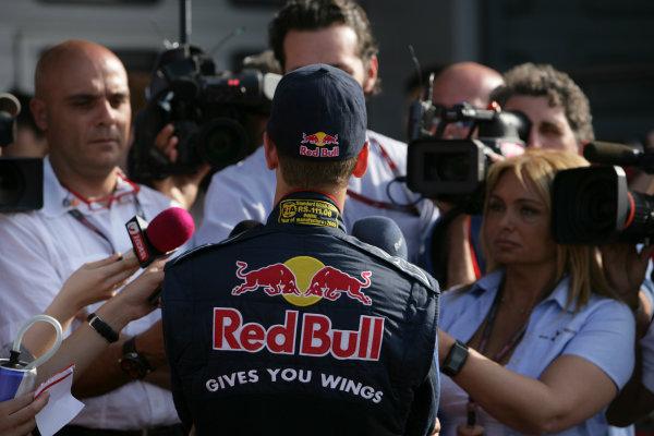 Shanghai International Circuit, Shanghai, China18th April 2009Sebastian Vettel, Red Bull Racing RB5 Renault, is interviewed. Portrait. Media. World Copyright: Charles Coates/LAT Photographicref: Digital Image ZK5Y9327