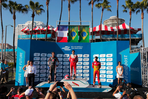 2014/2015 FIA Formula E Championship. Long Beach ePrix, Long Beach, California, United States of America. Sunday 5 April 2015 Podium. Nelson Piquet Jr (BRA)/China Racing - Spark-Renault SRT_01E, first, Jean-Eric Vergne (FRA)/Andretti Motorsport - Spark-Renault SRT_01E, second and Lucas di Grassi (BRA)/Audi Abt Sport - Spark-Renault SRT_01E, third. Photo: Zak Mauger/LAT/Formula E ref: Digital Image _MG_5739