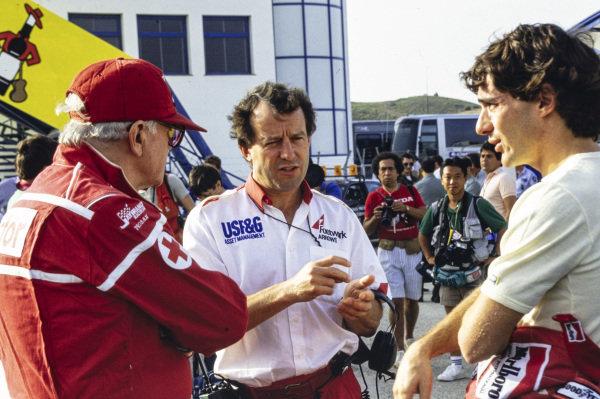 Jackie Oliver talks with Professor Sid Watkins and Ayrton Senna.