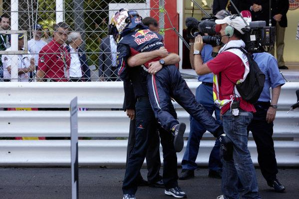 Christian Horner celebrates with race winner Sebastian Vettel in Parc Ferme.