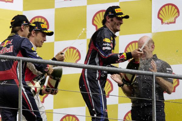 Sebastian Vettel, 1st position, celebrates on the podium with Mark Webber, 2nd position, Jenson Button, 3rd position, and Adrian Newey.