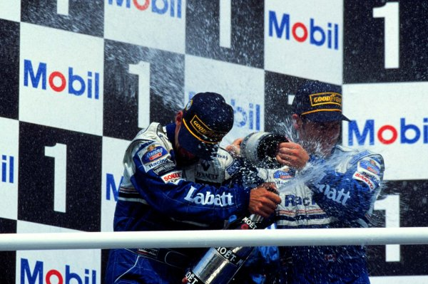 1996 German Grand Prix.Hockenheim, Germany.26-28 July 1996.Damon Hill (left) and Williams-Renault team mate Jacques Villeneuve celebrate finishing in 1st and 3rd positions respectively.World Copyright - LAT Photographic