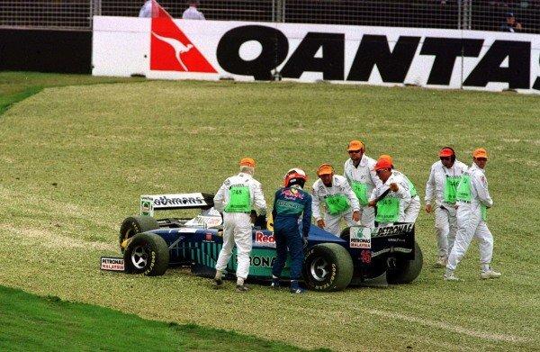 1997 Australian Grand Prix.Albert Park, Melbourne, Australia.7-9 March 1997.Johnny Herbert (Sauber C16 Petronas Ferrari) and Jacques Villeneuve (Williams FW19 Renault) after crashing at the first corner.World Copyright - LAT Photographic
