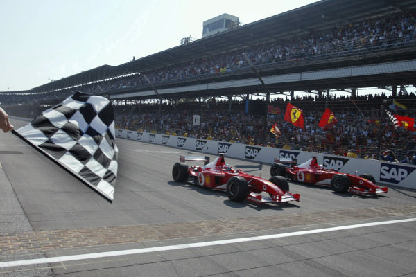 Rubens Barrichello, Ferrari F2002, (nearest camera), wins from Michael Schumacher, Ferrari F2002, who had slowed as he approached the finish line to allow his teammate alongside.