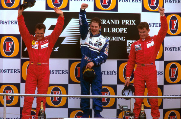 Nurburgring, Germany.26-28 April 1996.Jacques Villeneuve (Williams Renault) 1st position, Michael Schumacher (Ferrari) 2nd position and David Coulthard (McLaren Mercedes) 3rd position on the podium. Ref-96 EUR 07.World Copyright - LAT Photographic