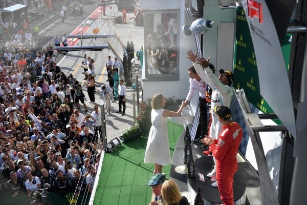 Lewis Hamilton, Mercedes AMG F1, 1st position, receives his trophy on the podium
