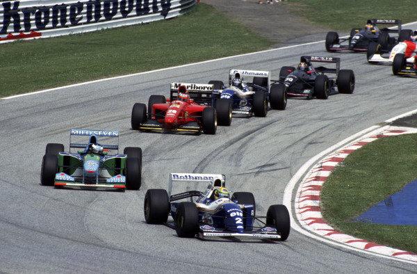 Ayrton Senna, Williams FW16 Renault, leads Michael Schumacher, Benetton B194 Ford, Gerhard Berger, Ferrari 412T1, Damon Hill, Williams FW16 Renault, and Heinz-Harald Frentzen, Sauber C13 Mercedes.