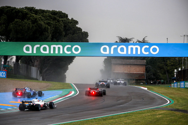 Fernando Alonso, Alpine A521, leads Sebastian Vettel, Aston Martin AMR21, Nicholas Latifi, Williams FW43B, and Nikita Mazepin, Haas VF-21