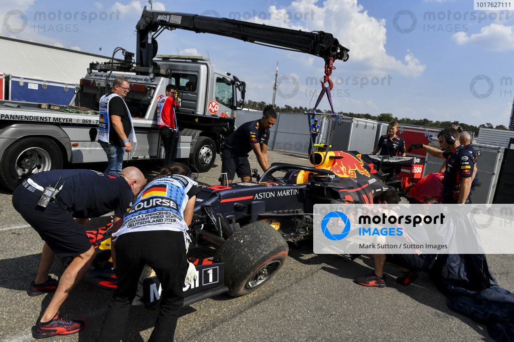 The damaged car of Pierre Gasly, Red Bull Racing RB15, is lifted from a truck