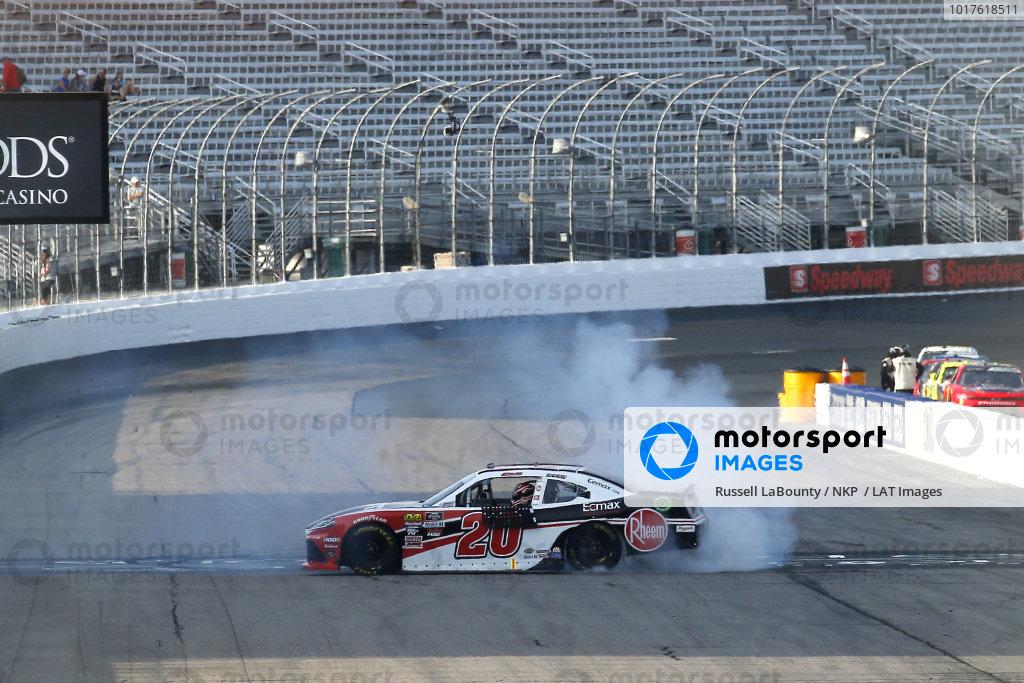 #20: Christopher Bell, Joe Gibbs Racing, Toyota Supra Rheem-Watts celebrates his win with a burnout