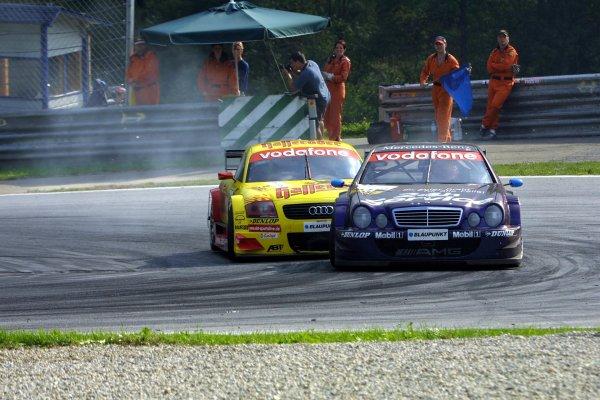 2002 DTM Championship A1 Ring, Austria. 7th - 8th September 2002. Stefan Muecke (AMG Mercedes) leads Laurent Aiello (Abt Audi), action.World Copyright: Andre Irlmeier/LAT Photographic