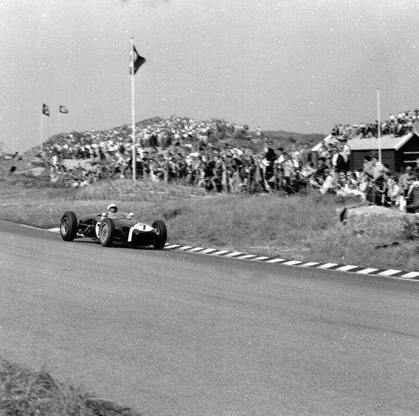 1960 Dutch Grand Prix.Zandvoort, Holland.4-6 June 1960.Stirling Moss (Lotus 18 Climax) 4th position.Ref-6564.World Copyright - LAT Photographic
