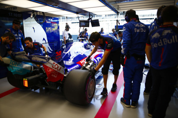 Brendon Hartley, Toro Rosso STR13 Honda, is pushed into the garage.