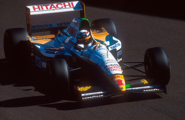 1994 Italian Grand Prix.Monza, Italy.9-11 September 1994.Alessandro Zanardi (Lotus 109 Mugen-Honda). He exited the race after being hit from behind. This cut and made his rear left tyre explode, he then went into Morbidelli and out of the race.Ref-94 ITA 13.World Copyright - LAT Photographic