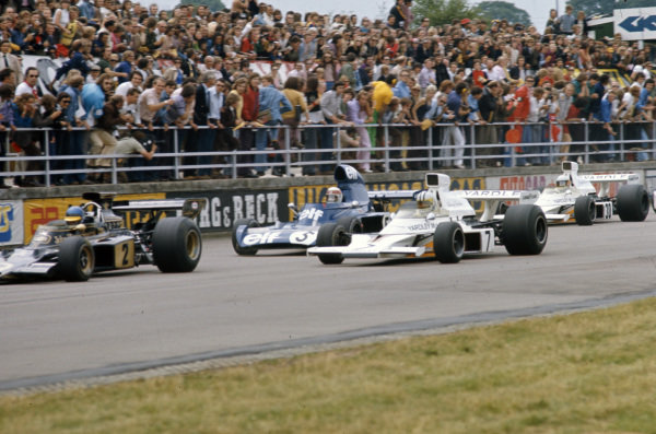 Ronnie Peterson, Lotus 72E Ford leads Denny Hulme, McLaren M23 Ford, Jackie Stewart, Tyrrell 006 Ford and Jody Scheckter, McLaren M23 Ford at the start.