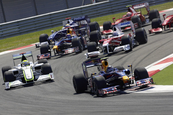Sebastian Vettel, Red Bull RB5 Renault leads Jenson Button, Brawn BGP 001 Mercedes and Jarno Trulli, Toyota TF109 leads at the start.