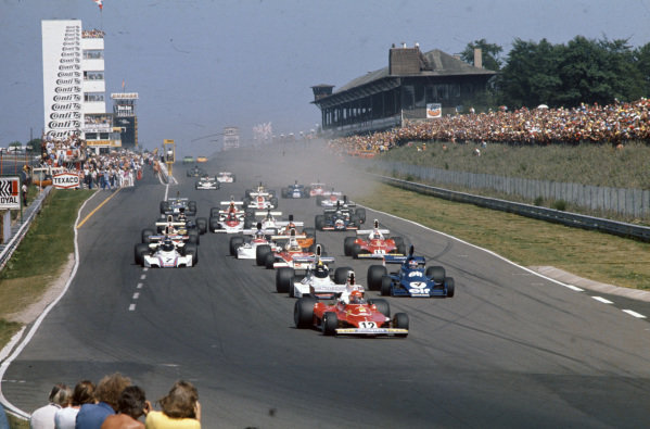 Niki Lauda, Ferrari 312T leads Carlos Pace, Brabham BT44B Ford and Patrick Depailler, Tyrrell 007 Ford at the start.