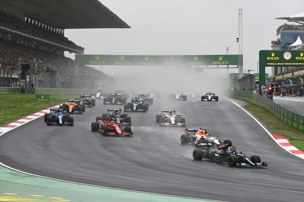 Valtteri Bottas, Mercedes W12, leads Max Verstappen, Red Bull Racing RB16B, Charles Leclerc, Ferrari SF21, Fernando Alonso, Alpine A521, Pierre Gasly, AlphaTauri AT02, and the rest of the field at the start