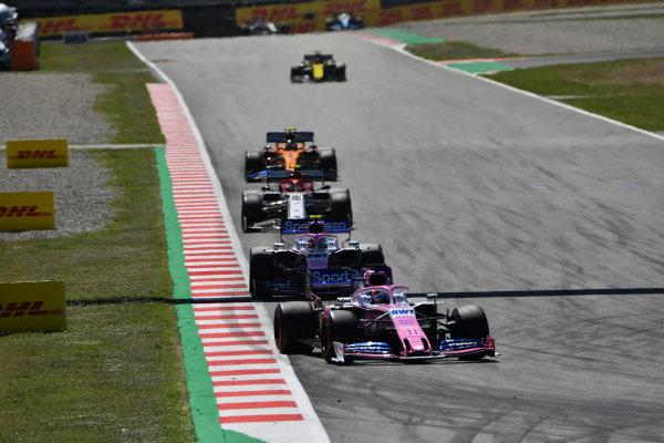 Sergio Perez, Racing Point RP19, leads Lance Stroll, Racing Point RP19, Antonio Giovinazzi, Alfa Romeo Racing C38, and Lando Norris, McLaren MCL34