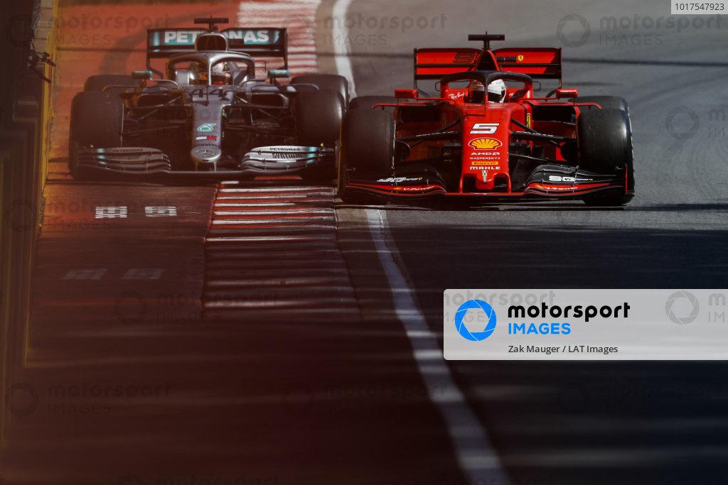 Sebastian Vettel, Ferrari SF90 and Lewis Hamilton, Mercedes AMG F1 W10 battle
