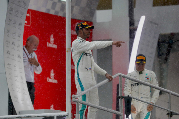 Lewis Hamilton, Mercedes AMG F1, and Valtteri Bottas, Mercedes AMG F1, celebrate on the podium.
