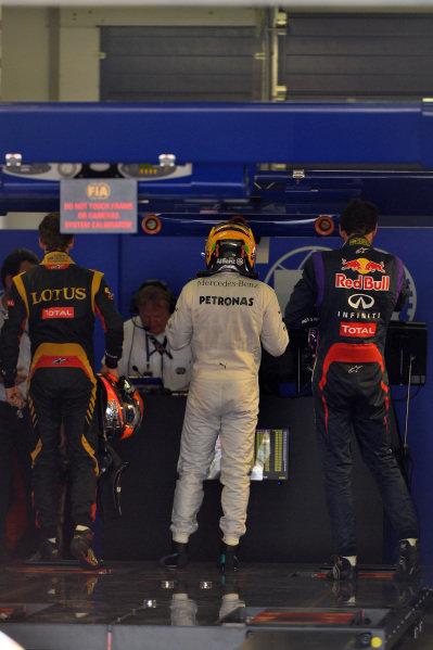Romain Grosjean (FRA) Lotus F1, Lewis Hamilton (GBR) Mercedes AMG F1 and Mark Webber (AUS) Red Bull Racing in parc ferme. Formula One World Championship, Rd9, German Grand Prix, Qualifying, Nurburgring, Germany, Saturday 6 July 2013.