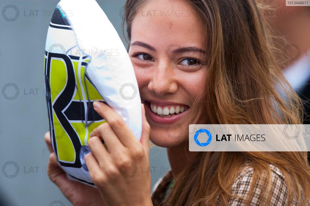 Suzuka Circuit, Suzuka, Japan.1st October 2009.Jessica Michibata hides behind a picture of the helmet of her boyfriend Jenson Button. Portrait.World Copyright: Andrew Ferraro/LAT Photographicref: Digital Image _H0Y1281