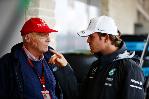 Circuit of the Americas, Austin, Texas, United States of America. Saturday 24 October 2015. Nico Rosberg, Mercedes AMG, with Niki Lauda, Non-Executive Chairman, Mercedes AMG, in the pit lane. World Copyright: Glenn Dunbar/LAT Photographic. ref: Digital Image _89P4779
