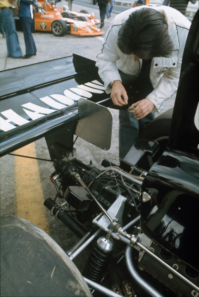 Nurburgring, Germany. 2nd - 4th August 1974.Tony Southgate works on the back of Jean-Pierre Jarier (Shadow DN3-Ford), portrait.World Copyright: LAT Photographic.Ref:  Colour Transparency.