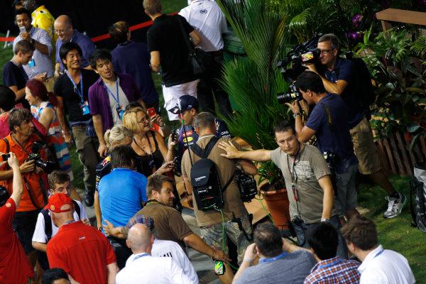 Marina Bay Circuit, Singapore. Saturday 21st September 2013. Sebastian Vettel, Red Bull Racing walks in teh paddock in a crowd of media. World Copyright: Charles Coates/LAT Photographic. ref: Digital Image _N7T5513
