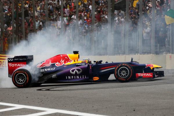 Interlagos, Sao Paulo, Brazil. Sunday 24rd November 2013.  Sebastian Vettel, Red Bull RB9 Renault, 1st position, celebrates victory with donuts. World Copyright: Andy Hone/LAT Photographic. ref: Digital Image _ONY0949