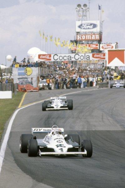 1981 Belgian Grand Prix.Zolder, Belgium. 15-17 May 1981.Alan Jones leads Carlos Reutemann (both Williams FW07C-Ford Cosworth). Reutemann finished in 1st position.World Copyright: LAT PhotographicRef: 35mm transparency 81BEL20