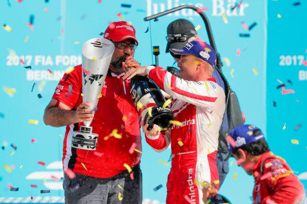 2016/2017 FIA Formula E Championship. Round 7 - Berlin ePrix, Tempelhof Airport, Berlin, Germany. Saturday 10 June 2017. Felix Rosenqvist (SWE), Mahindra Racing, Spark-Mahindra, Mahindra M3ELECTRO sprays the champagne on the podium. Photo: Zak Mauger/LAT/Formula E ref: Digital Image _54I7740