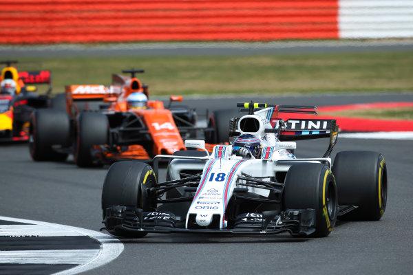 Silverstone, Northamptonshire, UK.  Sunday 16 July 2017. Lance Stroll, Williams FW40 Mercedes, leads Fernando Alonso, McLaren MCL32 Honda. World Copyright: Charles Coates/LAT Images  ref: Digital Image AN7T1677