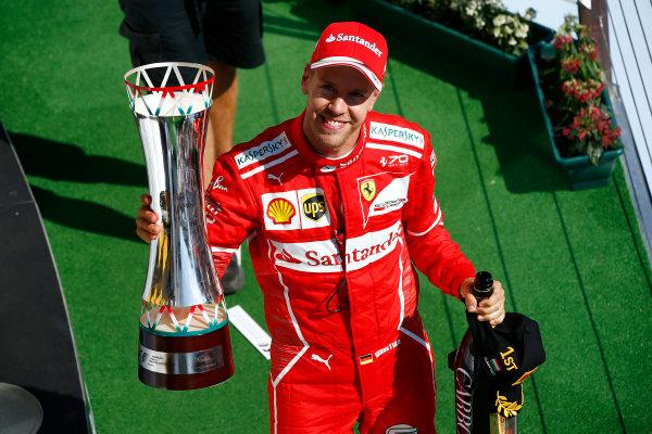 Hungaroring, Budapest, Hungary.  Sunday 30 July 2017. Sebastian Vettel, Ferrari, 1st Position, celebrates on the podium with his trophy. World Copyright: Andrew Hone/LAT Images  ref: Digital Image _ONZ1203