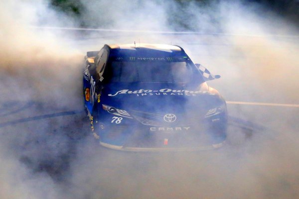 Monster Energy NASCAR Cup Series Go Bowling 400 Kansas Speedway, Kansas City, KS USA Saturday 13 May 2017 Martin Truex Jr, Furniture Row Racing, Auto-Owners Insurance Toyota Camry celebrates his win with a burnout  World Copyright: Russell LaBounty LAT Images ref: Digital Image 17KAN1rl_5818