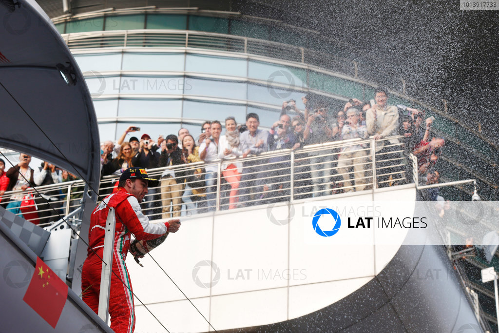 Shanghai International Circuit, Shanghai, China Sunday 14th April 2013 Fernando Alonso, Ferrari, 1st position, sprays Champagne from the podium. World Copyright: Charles Coates/LAT Photographic ref: Digital Image _N7T7497