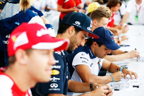 Hungaroring, Budapest, Hungary. Thursday 23 July 2015. Daniel Ricciardo, Red Bull Racing, and Felipe Massa, Williams F1, signs autographs for fans. World Copyright: Charles Coates/LAT Photographic ref: Digital Image _J5R0686