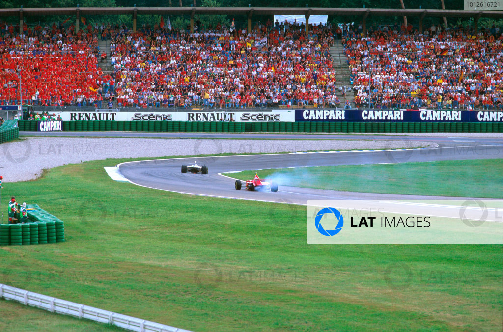 Hockenheim, Germany.25-27 July 1997.Eddie Irvine (Ferrari F310B) with a puncture after a collision with Frentzen on lap 1.Ref-97 GER 12.World Copyright - LAT Photographic