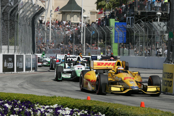 11-13 April, 2014, Long Beach, California USA Ryan Hunter-Reay leads the field into turm 2 at the start of the race ©2014, Leland Hill LAT Photo USA