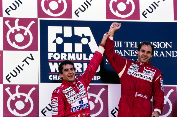 Ayrton Senna and Gerhard Berger celebrate on the podium.