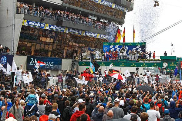 2015 Le Mans 24 Hours. Circuit de la Sarthe, Le Mans, France. Sunday 14 June 2015. Porsche Team (Porsche 919 Hybrid - LMP1), Nico Hulkenberg, Earl Bamber, Nick Tandy, Porsche Team (Porsche 919 Hybrid - LMP1), Timo Bernhard, Mark Webber, Brendon Hartley & Audi Sport Team Joest (Audi R18 E-Tron Quattro - LMP1), Marcel Fassler, Andre Lotterer, Benoit Treluyer, on the podium Photo:  Sam Bloxham/LAT Photographic. ref: Digital Image _G7C0036