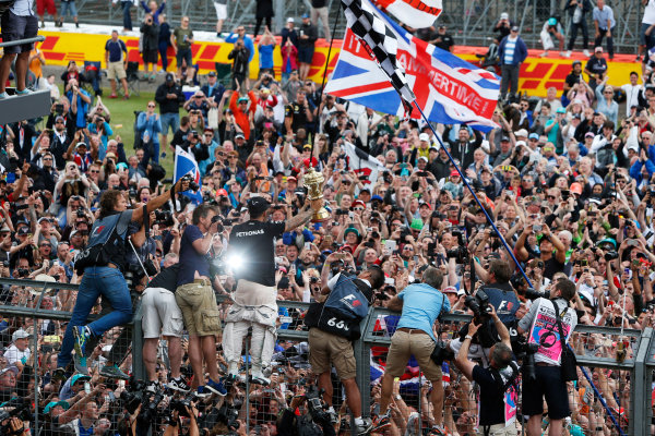 Silverstone Circuit, Northamptonshire, England. Sunday 5 July 2015. Lewis Hamilton, Mercedes AMG, 1st Position, celebrates with the fans. World Copyright: Andrew Ferraro/LAT Photographic ref: Digital Image _FER0500