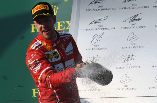 Sebastian Vettel (GER) Ferrari celebrates on the podium with the champagne at Formula One World Championship, Rd1, Australian Grand Prix, Race, Albert Park, Melbourne, Australia, Sunday 26 March 2017.
