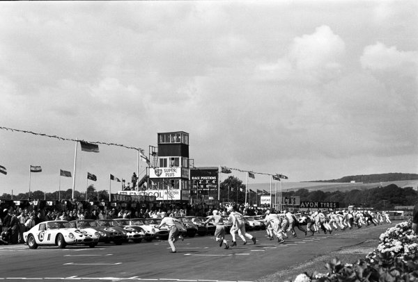 Start of the race, drivers run to the cars in a Le Mans type start. RAC Tourist Trophy, Goodwood, England, 18 August 1962.